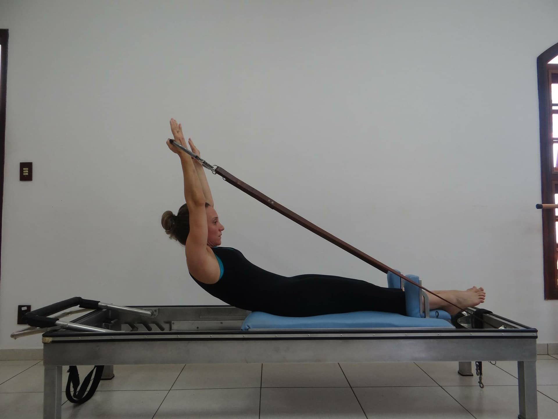 A woman doing pilates physical therapy