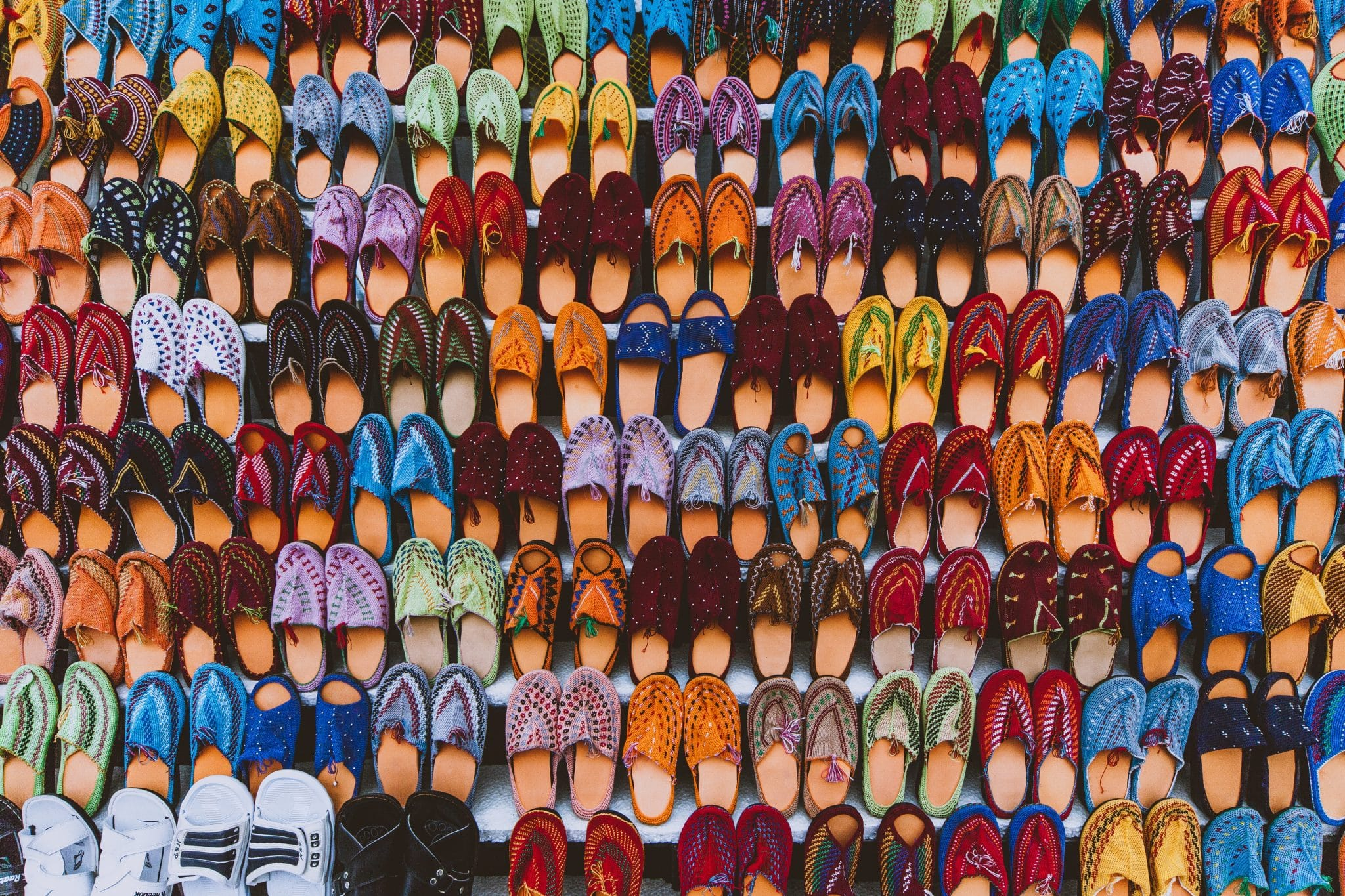 Colorful shoes lined up in a nice pattern