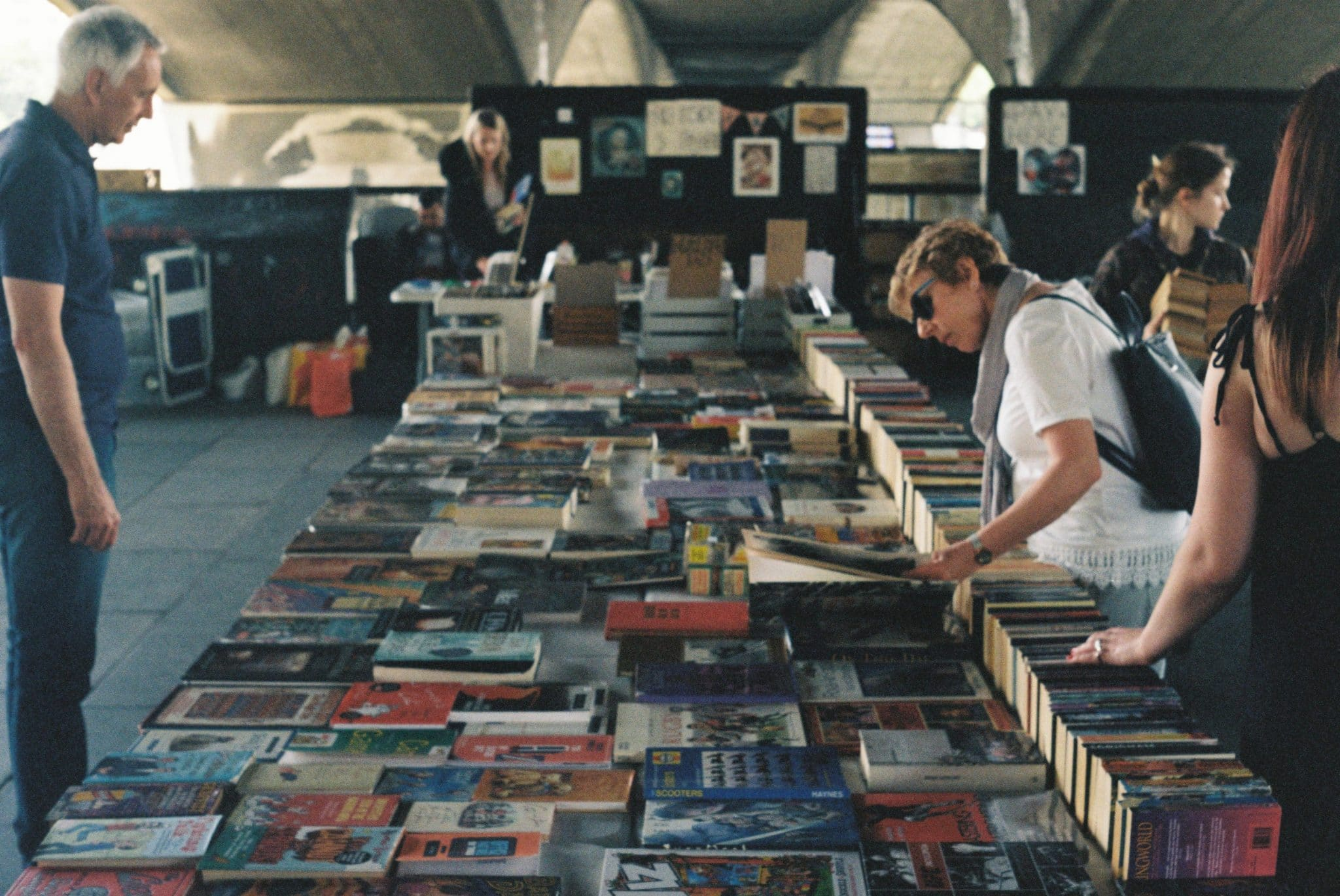 People shopping in a second-hand book store.