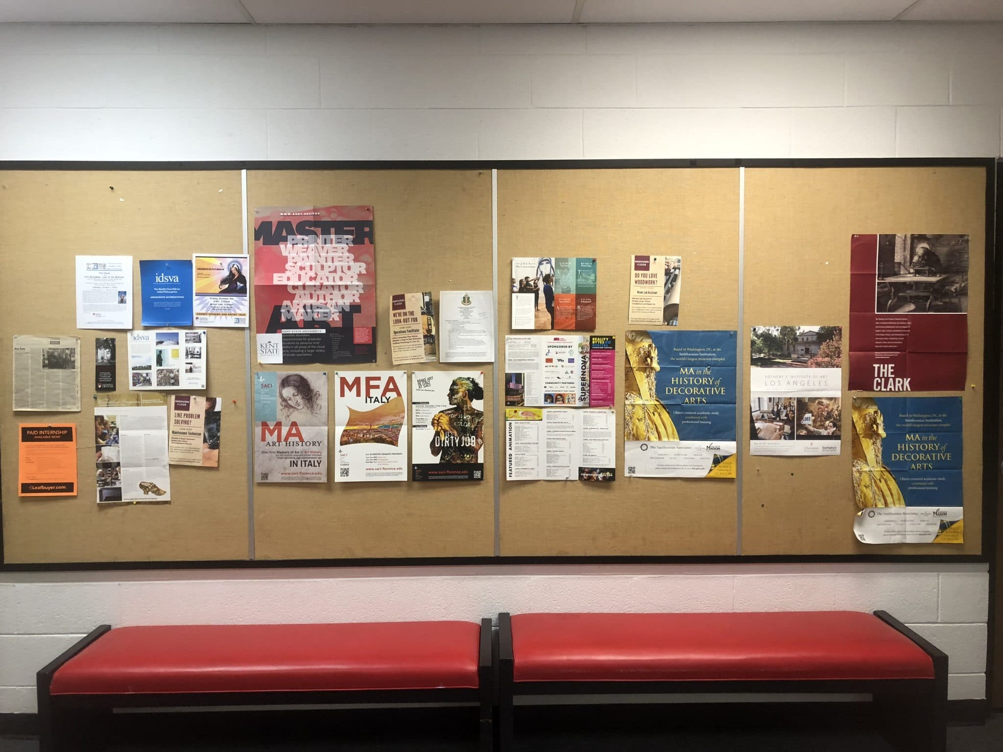 Bulletin board of fliers for art students in the lobby of the DU school of art.