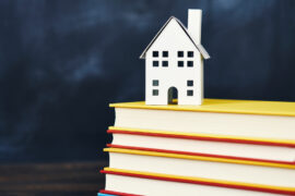 a house on a stack of books representing homeschool