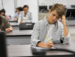 male student taking act exam