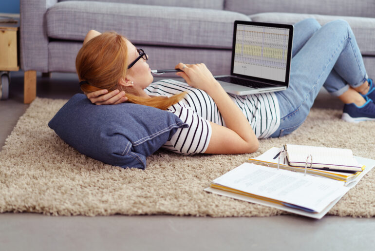 busy woman taking online college course at home