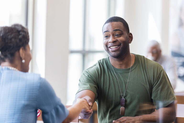 military veteran speaks with vet success counselor about college life