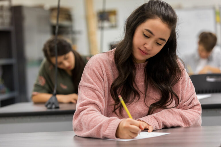 Female students taking standardized tests