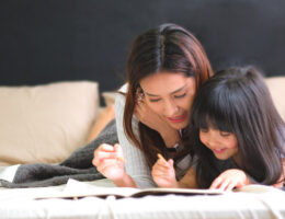 mother homeschooling her daughter