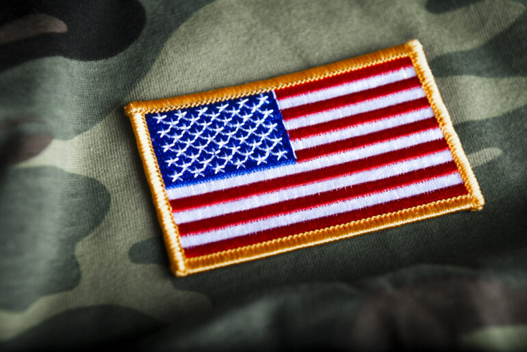 military officer in training and American flag patch